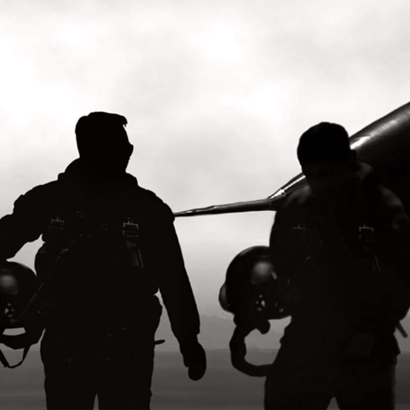 Military pilots walking away from jet