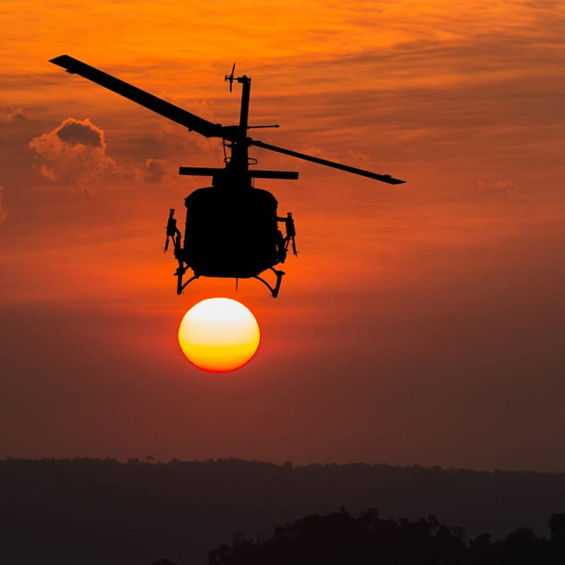 helicopter in sunset logo